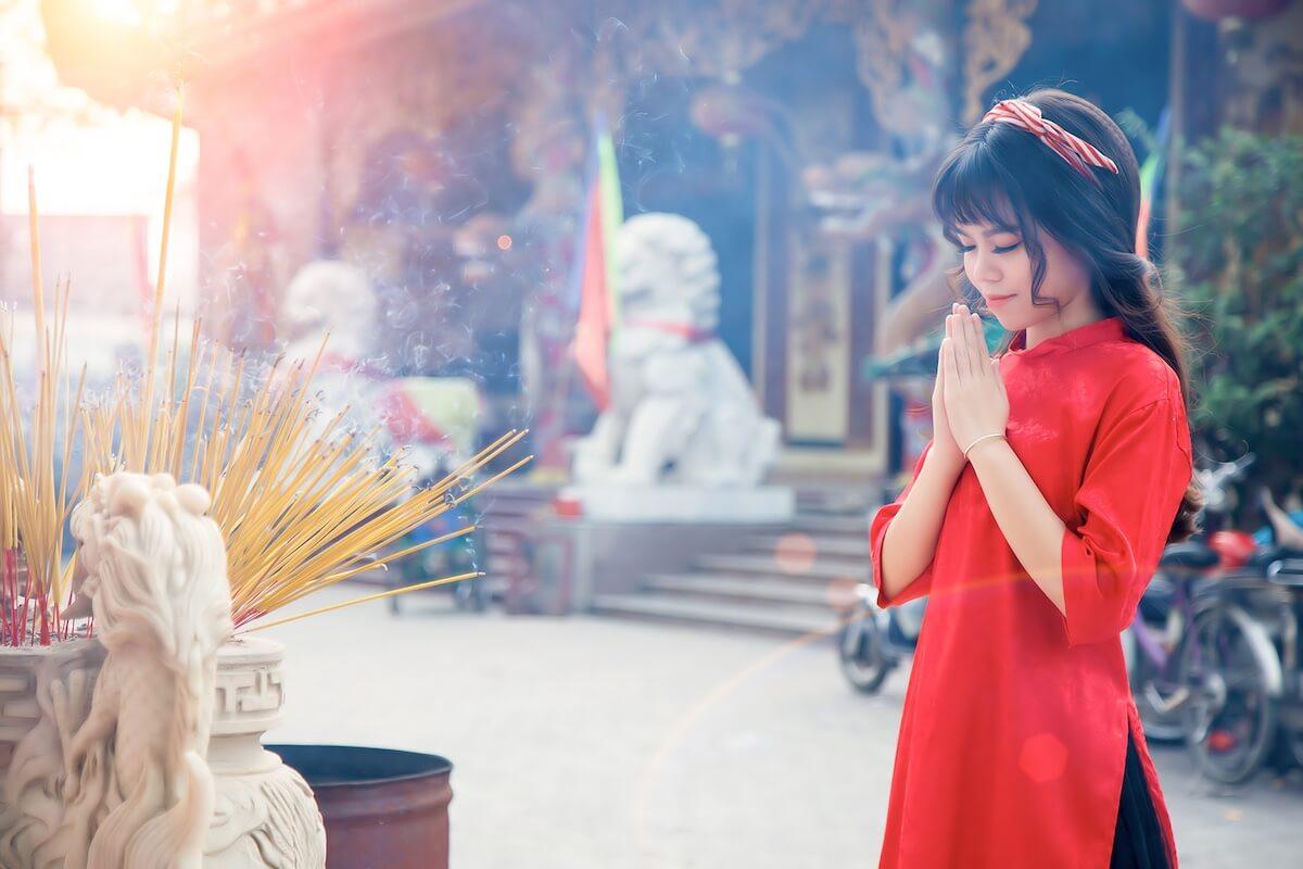 visiting pagoda on Tet holiday in Vietnam